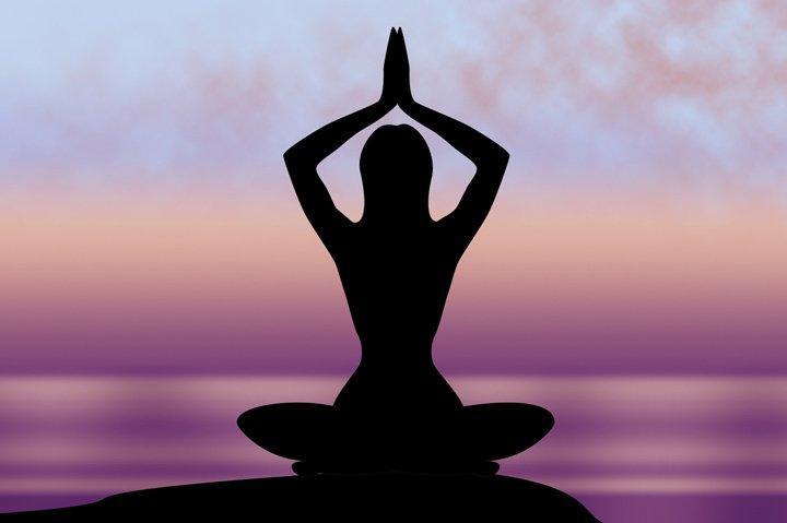 Woman meditating and feeling at peace